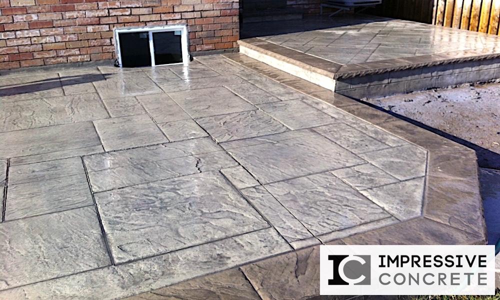 Impressive Concrete - Concrete Patios Portfolio - 001- Stamped Concrete Yorkstone Pattern Two Colors Patio