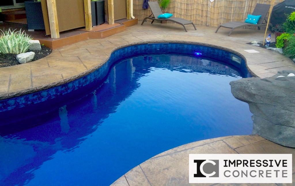 Impressive Concrete - Concrete Pool Decks Portfolio - 005 - Stamped Concrete Yorkstone Pattern Pool Deck, Chisel Bullnose