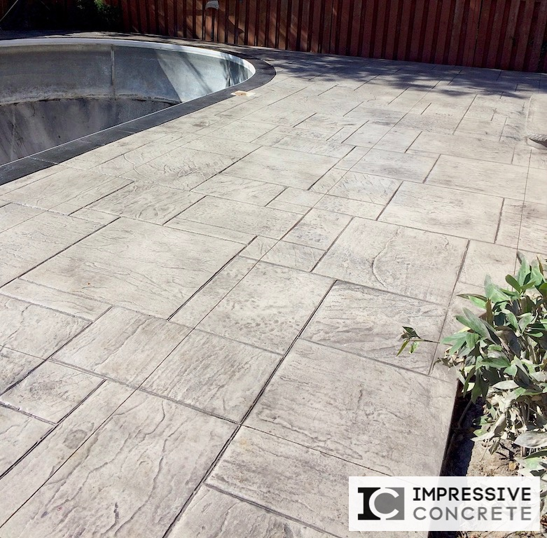 Impressive Concrete - Concrete Pool Decks Portfolio - 009 - Stamped Concrete Yorkstone Pattern Two Colors Pool Deck