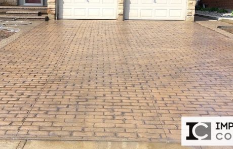 Impressive Concrete Portfolio - Concrete Driveways - 002 - Combination Stamped Concrete Brick Running Bone Pattern Driveway, Exposed Aggregate Concrete Border, One Color