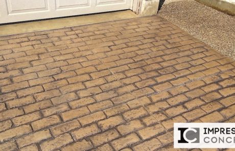 Impressive Concrete Portfolio - Concrete Driveways - 003 - Combination Stamped Concrete Brick Running Bone Pattern Driveway, Exposed Aggregate Concrete Border